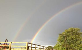 Double rainbow above equestrian riding arena With Post & Rail Fence Located In East Yorkshire