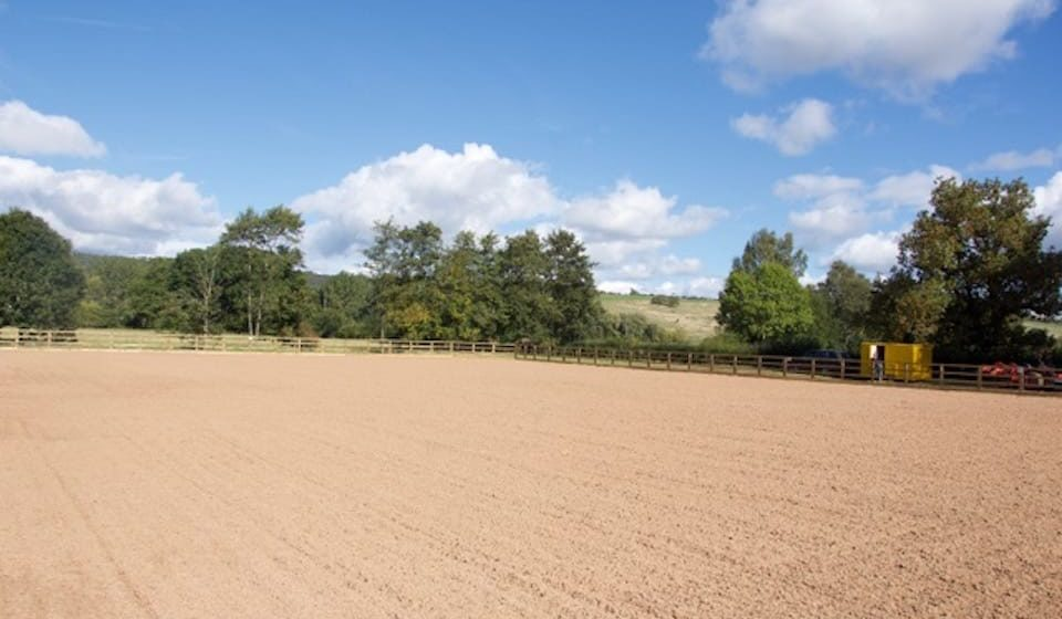 neatly levelled surface of empty equine arena